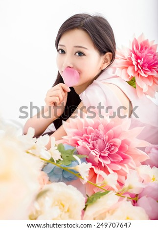 Asian woman in flower with petal - stock photo
