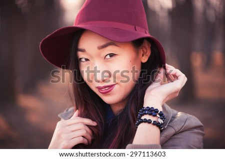Asian woman in hat - stock photo