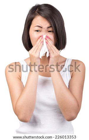 Asian woman is suffering from colds and runny nose. Portrait on white background. - stock photo
