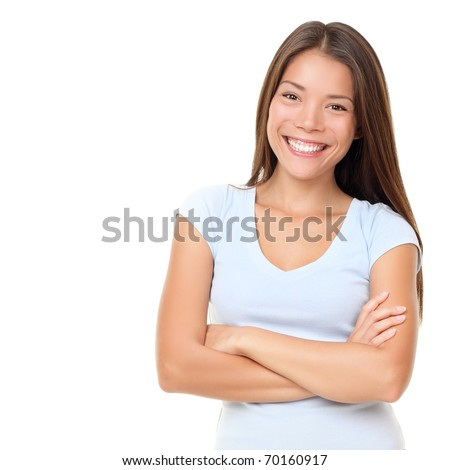 Asian woman isolated on white background. Casual mixed-race Asian Caucasian woman smiling looking happy in light blue t-shirt. - stock photo
