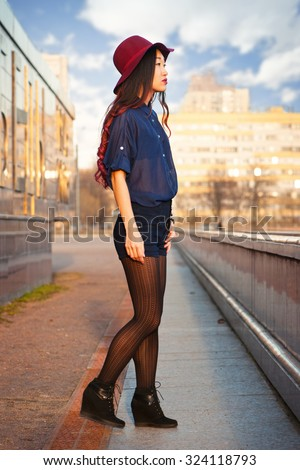 Asian woman outdoors in the city - stock photo