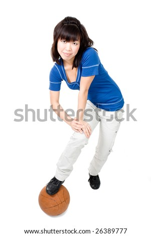 Asian woman playing with orange ball - stock photo