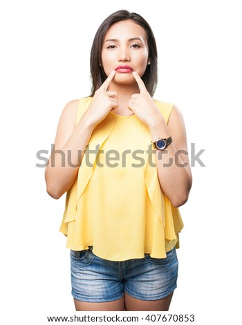 asian woman pointing her mouth - stock photo
