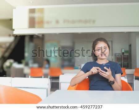Asian woman relax, texting on mobile phone. - stock photo