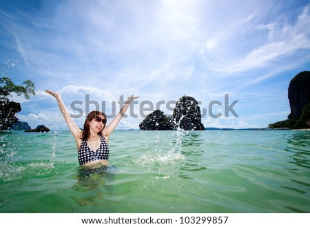 Asian woman relaxing on the sea, ocean - stock photo