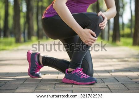 Asian woman runner hold Knee Pain ,Human Leg, jogging - stock photo