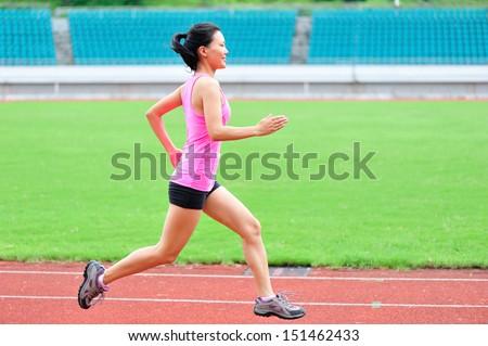 asian woman runner running  - stock photo