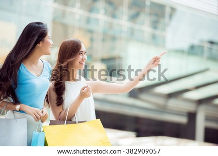 Asian woman shopping Discounted products in a mall. she was very excited - stock photo