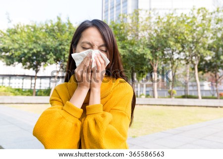 Asian Woman sneezing - stock photo