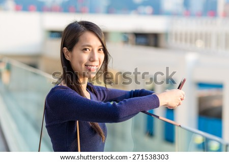 Asian woman using smartphone at outdoor - stock photo