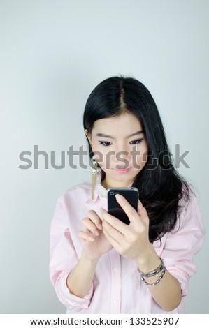 Asian woman using smartphone , communication concept - stock photo