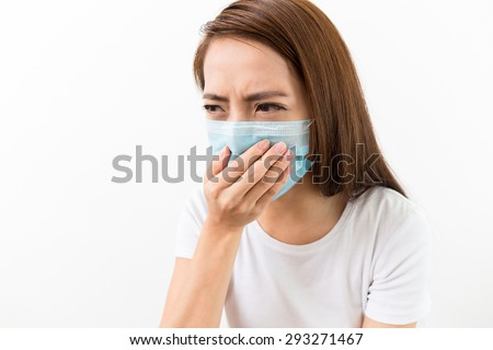 Asian woman using the medical face mask - stock photo