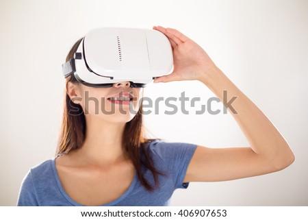 Asian woman using virtual reality device - stock photo