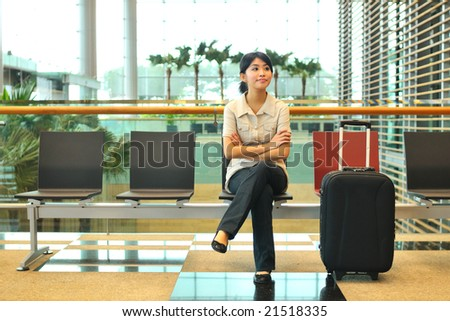 asian woman waiting at airport - stock photo