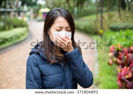 Asian Woman wear facemask outdoor - stock photo