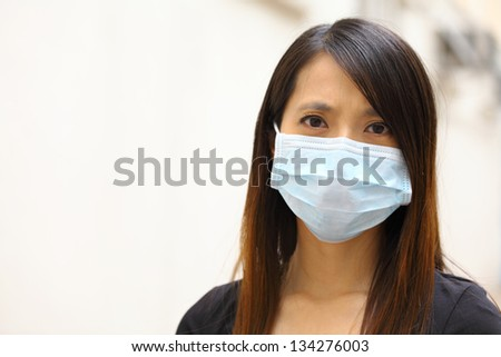 Asian woman wearing face mask - stock photo