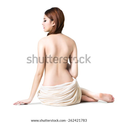 Asian woman wearing towel sitting on the floor back view, Isolated over white - stock photo