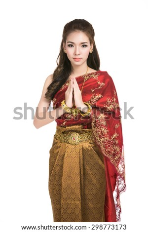 Asian woman wearing typical,traditional Thai dress with identity Thai culture Sawasdee,Welcome expression Sawasdee,vintage Thai girl,Happy asian woman with blank copyspace,isolated on white background - stock photo