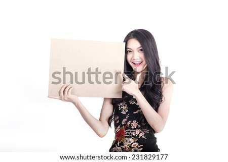 Asian woman with Chinese traditional dress cheongsam or qipao, holding blank  placard. Chinese new year concept, female model isolated on white background. - stock photo