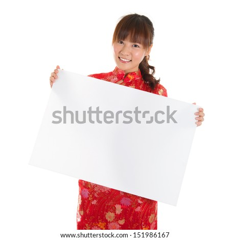Asian woman with Chinese traditional dress cheongsam or qipao, holding blank white card. Chinese new year concept, female model isolated on white background. - stock photo