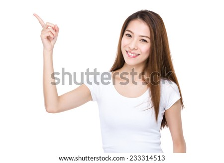 Asian Woman with finger point up - stock photo