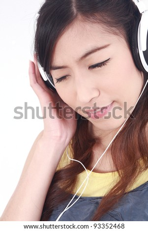 Asian Woman with headphones listening to music - isolated over a white background - stock photo