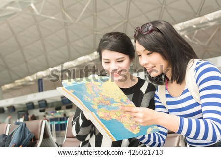 Asian woman with her friend traveling abroad - stock photo