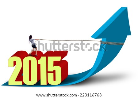 Asian woman with number 2015 pulls upward arrow, isolated over white background - stock photo