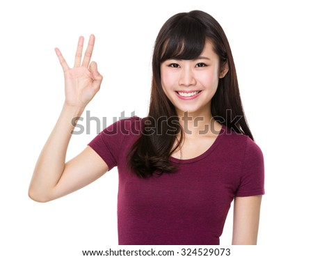 Asian Woman with ok sign gesture - stock photo