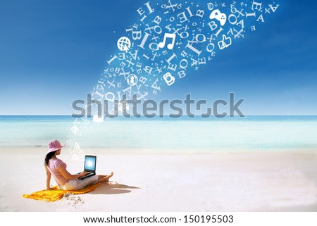 Asian woman with pink hat working on the beach in Queensland, Australia with flying alphabet  - stock photo
