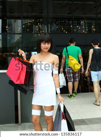 Asian woman with shopping bag at department store - stock photo