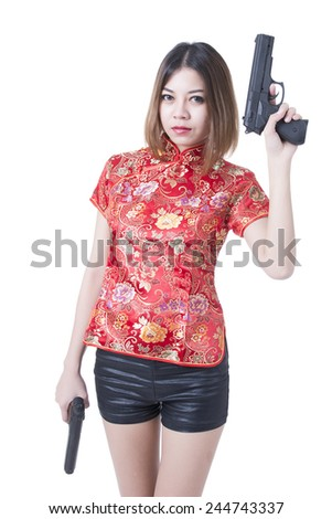 Asian woman with the gun on her hand Isolate on white background - stock photo