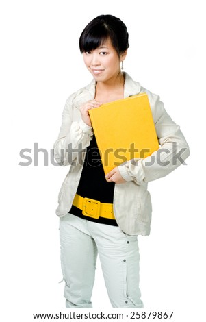 Asian woman with yellow book and big belt in white - stock photo