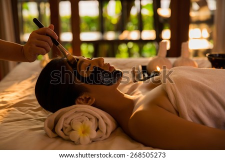 Asian women are doing spa has massage her skin to mask the early morning hours - stock photo