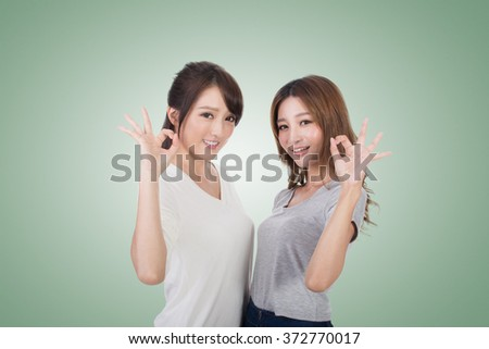 Asian women give you a sign of okay. - stock photo