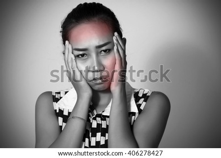 Asian women There are many have a headache and  toothache after orthodontics on white background - stock photo