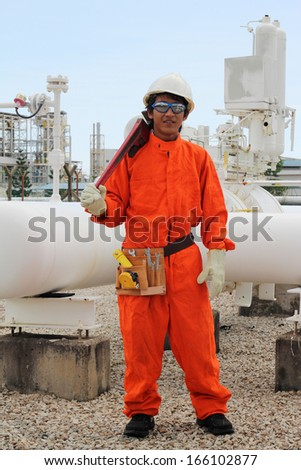 asian worker work at pipe line - stock photo