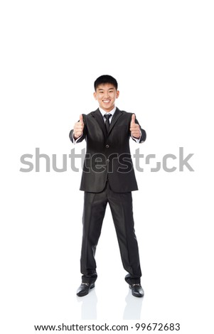 asian young business man hold hand with thumb up gesture, handsome businessman happy smile full length portrait, wear elegant suit and tie isolated over white background - stock photo