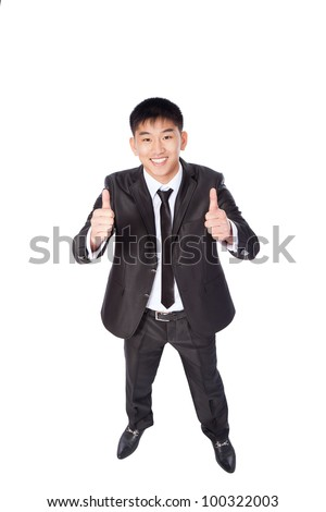 asian young business man hold hand with thumb up gesture, handsome businessman happy smile, wear elegant suit and tie, top angle view full length portrait isolated over white background - stock photo