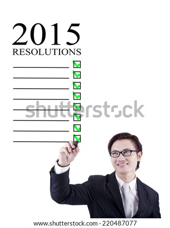 Asian young business person make a list of his resolutions in 2015 - stock photo