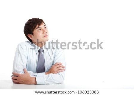 asian young businessman looking up - stock photo