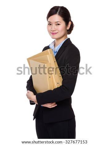 Asian young businesswoman hold with folder - stock photo