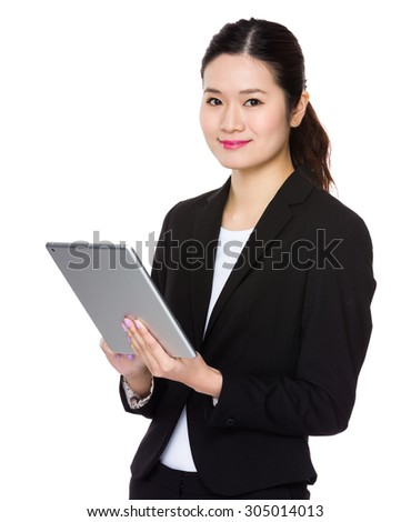 Asian Young businesswoman use of the tablet pc - stock photo