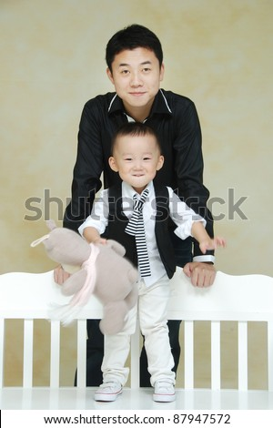 Asian young father  with cute child - stock photo