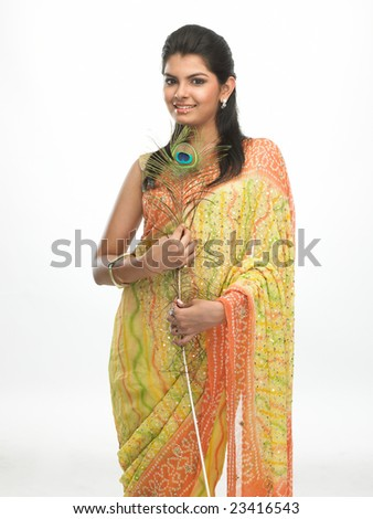 Asian young girl with the peacock feather - stock photo