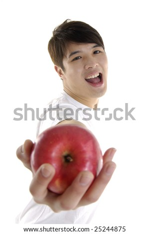 Asian young man holding apple - stock photo