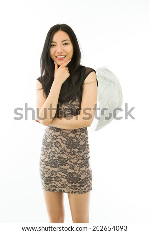 Asian young woman dressed up as an angel smiling isolated on white background - stock photo