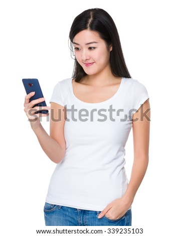 Asian Young Woman play the game on cellphone - stock photo