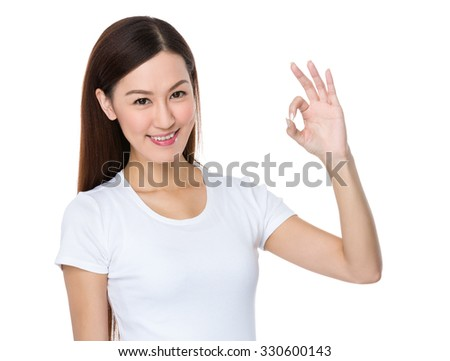 Asian Young Woman with ok sign gesture - stock photo