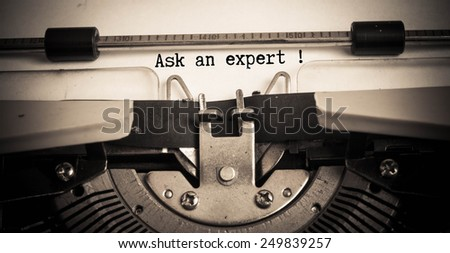 Ask an expert concept on typewriter  - stock photo